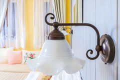 Vintage wall lamp in the bed room Stock Photos
