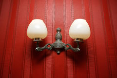 Vintage wall lamp on the red background Royalty Free Stock Photography