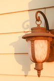 Vintage wall lamp on wood background. Vintage wall lamp on yellow wood wall Royalty Free Stock Photo