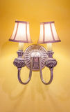 Vintage wall lamp on the yellow wall Stock Image