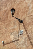 Vintage Wall-mounted Light on the Rough Wall Stock Images