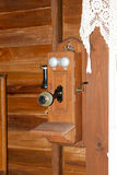 Vintage Wall Phone. Ancient wooden, crank style telephone Royalty Free Stock Photo
