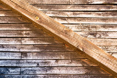 Vintage wall from wooden boards and massive joist across.  Royalty Free Stock Photos