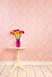 Vintage wall and wooden floor with vase flowers on table Royalty Free Stock Photo