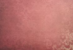Vintage wallpaper background. Antique vintage wallpaper in a faded red and cream floral pattern.   background grunge Stock Photos