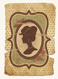 Vintage wallpaper with female silhouette Royalty Free Stock Photography