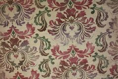 Vintage wallpaper floral pattern background. Antique vintage wallpaper in a red, green and cream floral pattern.   background grunge Royalty Free Stock Image