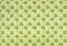 Vintage wallpaper - leaves. Used vintage wallpaper with leaves, natural grainy surface Stock Photography