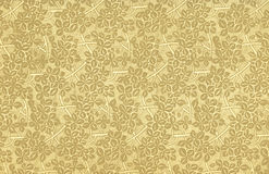 Vintage wallpaper with leaves. Used vintage wallpaper with leaves and branches in beige - grainy surface Royalty Free Stock Photos