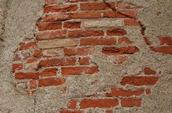 Vintage wallpaper with red bricks of a destroyed building stock images