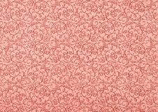 Vintage Wallpaper in Rouge with Spirals. Used vintage wallpaper in rouge with floral spirals, grainy surface Stock Image