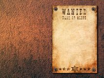 Vintage wanted poster. Antique page - wanted dead or alive. Vintage wanted poster attached with nails on painted walls royalty free stock images