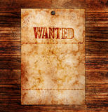 Vintage wanted poster. On a wooden wall royalty free stock photography