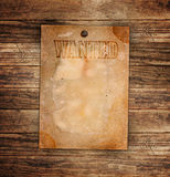 Vintage wanted poster on a wooden Royalty Free Stock Images