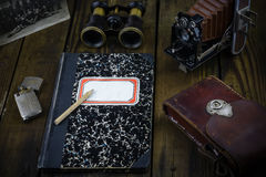 Vintage war correspondent reporter diary with binocular, camera, leather holster, lighter, vintage photo soldiers from 1900 year Stock Image