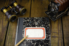 Vintage war correspondent reporter diary with binocular and camera Royalty Free Stock Photography