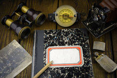 Vintage war correspondent reporter diary with binocular, camera, wrist compass, lighter, vintage photo soldiers from 1900 year Stock Image