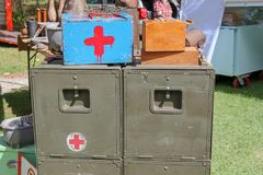 Vintage war themed medicine cabinet for sale. At market. Contains red medic cross stock photography