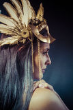 Vintage warrior woman with gold mask, long hair brunette. Long h Royalty Free Stock Photos