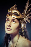 Vintage warrior woman with gold mask, long hair brunette. Long h Stock Photo