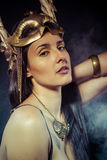 Vintage warrior woman with gold mask, long hair brunette. Long h Royalty Free Stock Photo