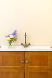 Vintage washbasin and wooden cabinet Royalty Free Stock Photography