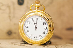 Vintage watch on antique map Royalty Free Stock Photos