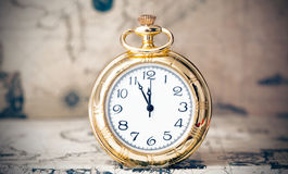 Vintage watch on antique map. Retro still life Royalty Free Stock Photo