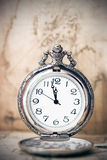 Vintage watch on antique map. Retro still life Stock Image