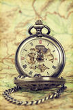 Vintage watch on antique map. Retro still life Royalty Free Stock Image