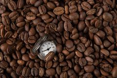 Vintage watch with coffee stock photo