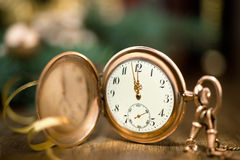 Vintage watch on a festive background showing five to midnight Royalty Free Stock Photography
