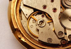 Vintage watch mechanism #2. A real macro of a very old open wrist watch, you can see some corroded parts and precious stones, all brand names have been removed Royalty Free Stock Photography