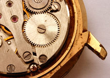Vintage watch mechanism. A real macro of a very old open wrist watch, you can see some corroded parts and precious stones, all brand names have been removed Stock Photography