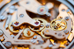 Vintage watch movement close-up. A vintage wind-up watch showing the complex movement of cogs, wheels and jewel parts Stock Photos