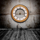 Vintage watch in old grunge room Royalty Free Stock Image