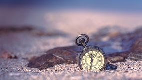 Vintage Watch Pendant On Beach royalty free stock photography