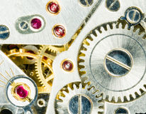 Vintage Watch Pocketwatch Time Piece Movement Gears Cogs. Extreme close up of the inside workings of a 17 jewels pocketwatch Royalty Free Stock Photo