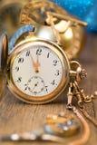 Vintage watch showing five to twelve Stock Photos