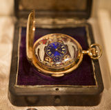 Vintage Watch. Victorian Era pocket watch in a velvet lined box on a buff colored cloth Stock Photography