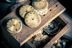 Vintage watchmaker's room full of clocks. Closeup of vintage watchmaker's room full of clocks royalty free stock photo
