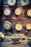 Vintage watchmaker's workshop with damaged clocks. Closeup of vintage watchmaker's workshop with damaged clocks royalty free stock photo