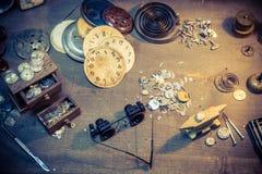 Vintage watchmaker's workshop full of clocks. Closeup of vintage watchmaker's workshop full of clocks stock photos