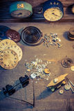 Vintage watchmaker's workshop with many clocks. Closeup of vintage watchmaker's workshop with many clocks royalty free stock images