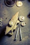 Vintage watchmakers room and damaged watch to fix. On wooden table Stock Images