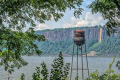 Vintage Water Tower on the Hudson River Royalty Free Stock Photography