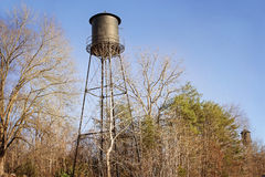 Vintage water towers among trees Stock Image
