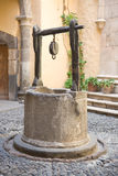 Vintage water well Stock Photos