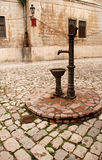 Vintage water well in a medieval town in Kotor Royalty Free Stock Photo