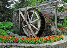 Vintage watermill. In historic butchart gardens (built in 1893), victoria, british columbia, canada Royalty Free Stock Image